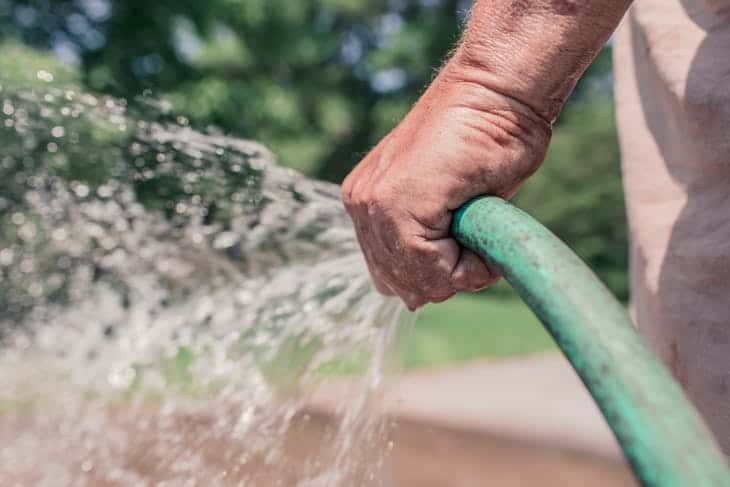 Using a garden hose without a nozzle leads to an inefficient way of watering your garden