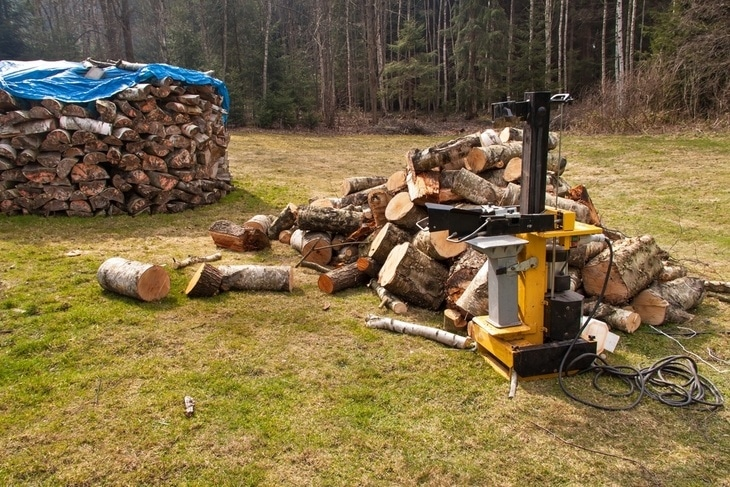 A shed filled with firewood, all thanks to electric log splitters