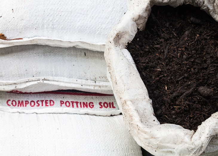 A big white bag of composted potting soil