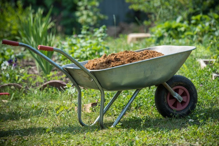A wheelbarrow can be used to carry garden soil