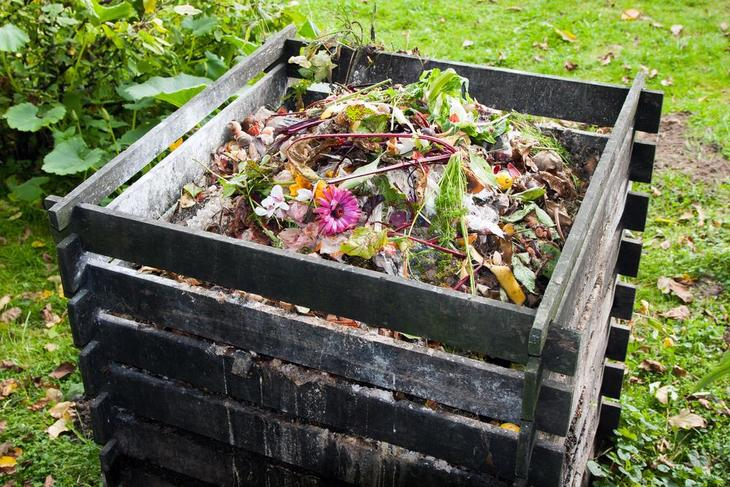 A traditional compost bin without lid
