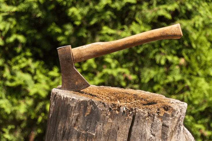 An axe is used to cut woods into small pieces.