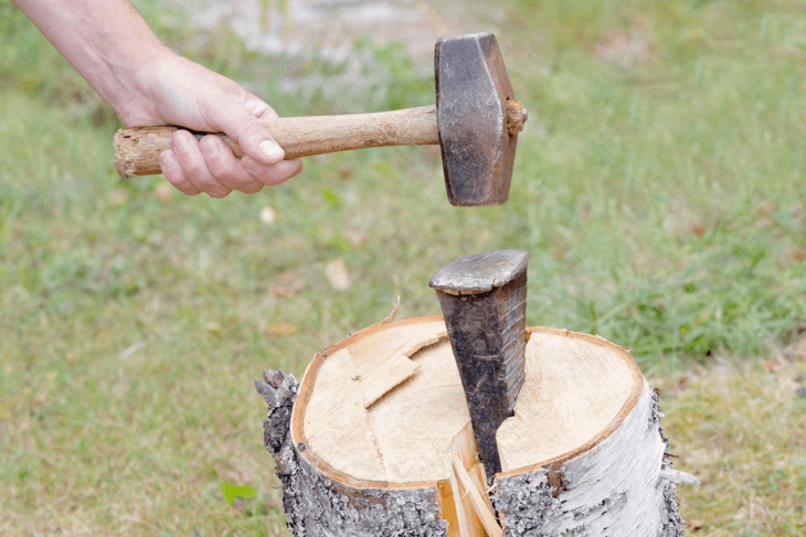 Splitting wedges are used to assist any tool in chopping large woods.