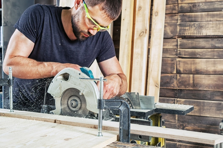 A hybrid table saw is smaller than that of a standard contractor's saw