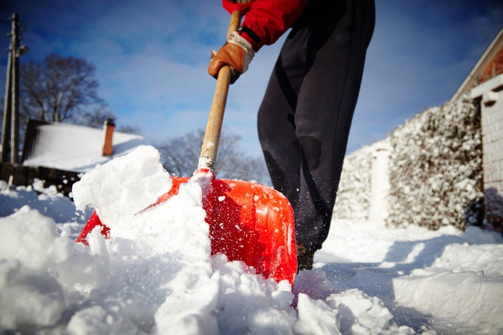 Using a shovel to clear up the snow in your backyard can cause back pain and muscle strain