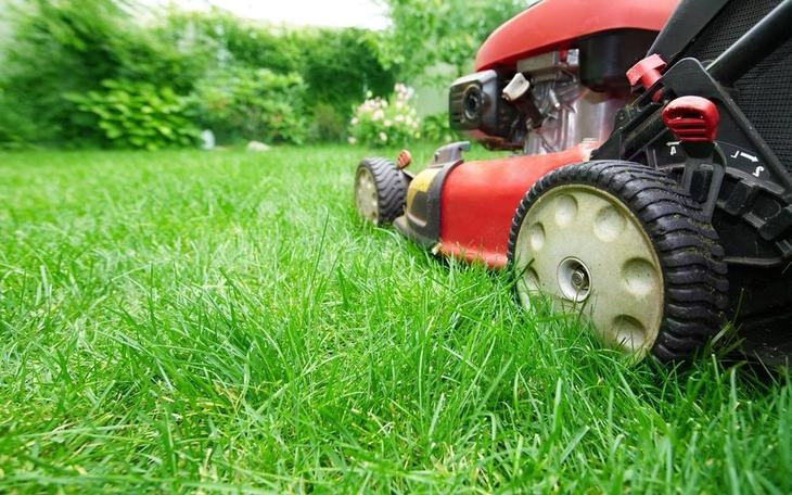 A rear-engine riding mower is designed for mowing