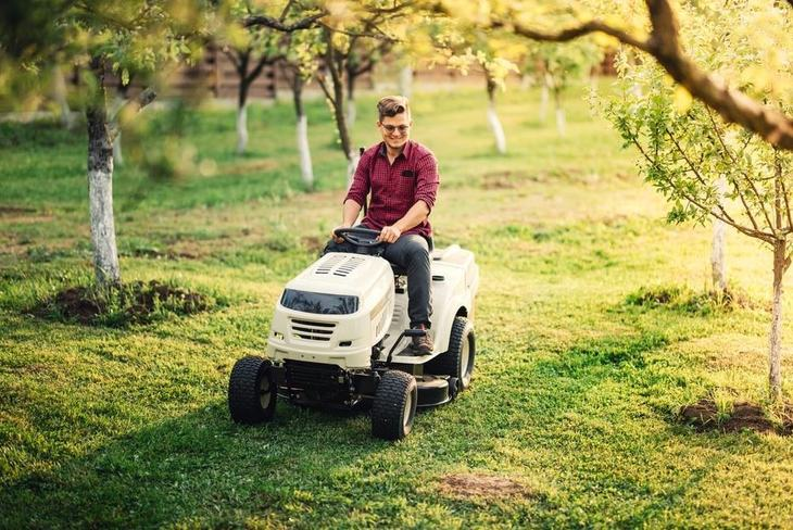 Driving a riding lawn mower is similar to driving other vehicles, with the driver sitting on the top of the deck