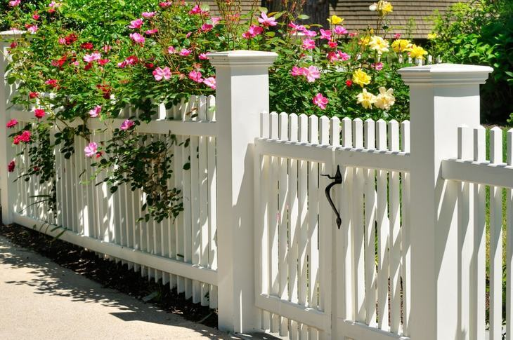 Fences like these may require several digging sessions and an earth auger can help the job easier