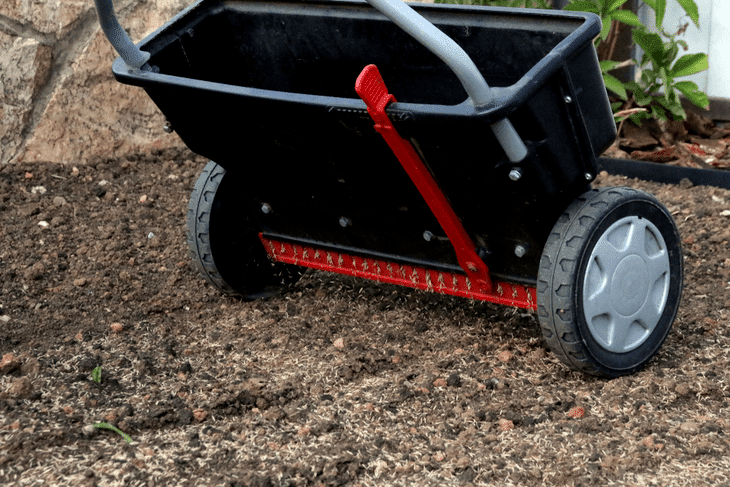 A walk behind spreader is the most ideal for a small garden as it is cheap and the easiest to use