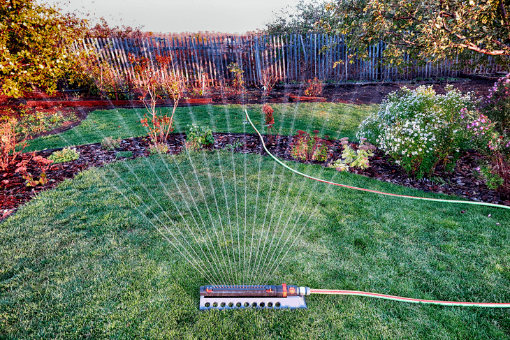 An oscillating lawn sprinkler provides ease and convenience in watering large areas of lawns and gardens