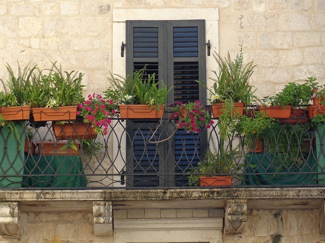 balcony with plant box and square foot garden spacing