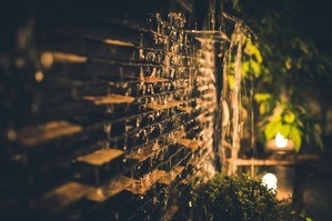 Solar garden lights near a brick wall